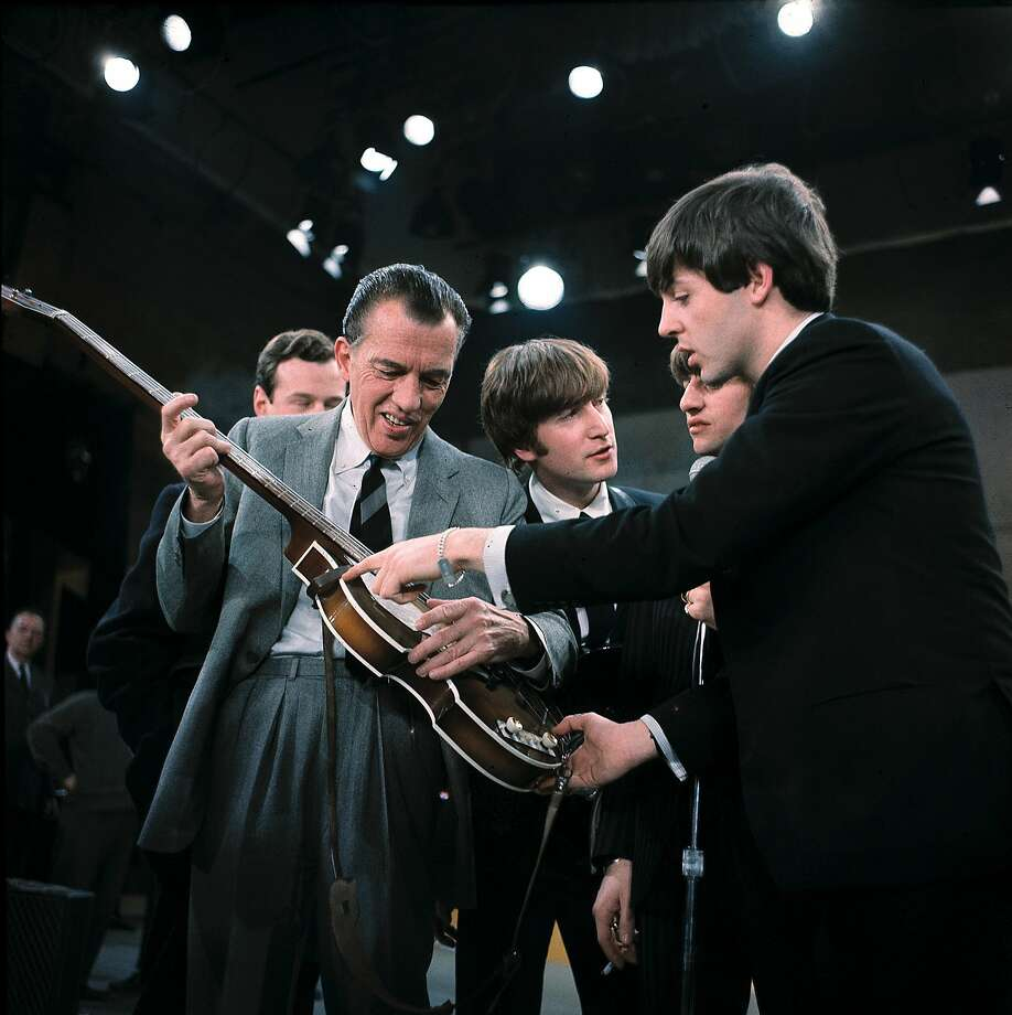 Paul McCartney shows his guitar to Ed Sullivan before the Beatles' live television appearance on Sullivan's show in 1964. Photo: Uncredited, Associated Press