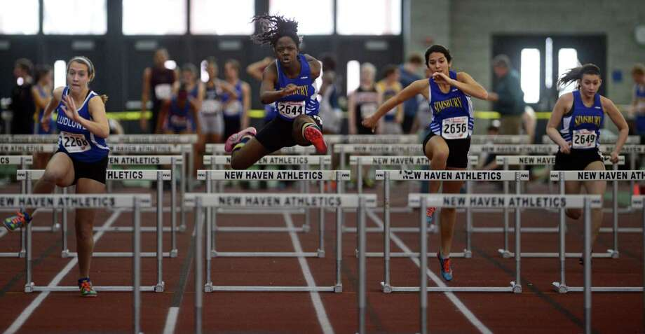 Athletes compete Saturday, Feb. 8, 2014, during the CIAC Class LL Boys and Girls track championships at the Floyd Little Athletic Center in New Haven, Conn. Photo: Autumn Driscoll / Connecticut Post