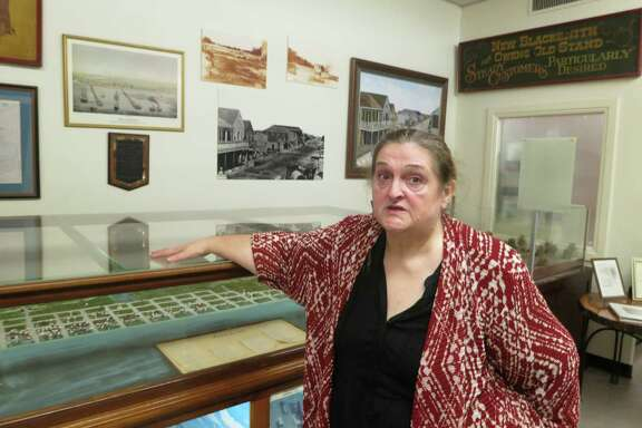 George Anne Cormier, director of the Calhoun County Museum, can take visitors through a scale model of old Indianola, part of the museum's exhibit on the town.
