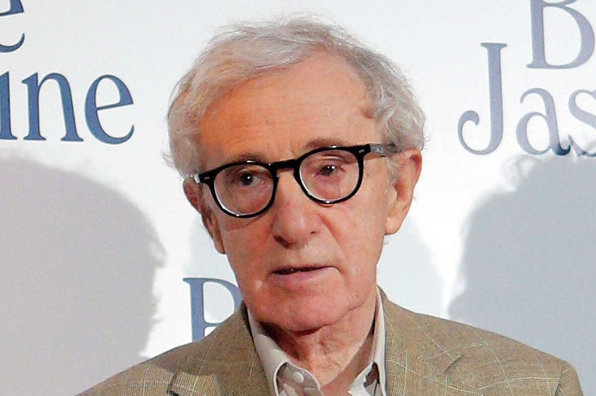 """FILE - This Aug. 27, 2013 file photo shows director and actor Woody Allen at the French premiere of """"Blue Jasmine,"""" in Paris. Allen is again denying he molested adoptive daughter Dylan Farrow and is calling ex-partner Mia Farrow vindictive, spiteful and malevolent in an open-letter published online Friday, Feb. 7, 2014 by The New York Times."""