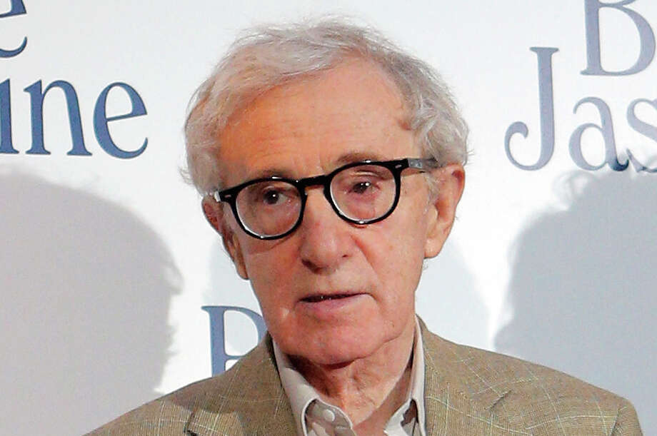"FILE - This Aug. 27, 2013 file photo shows director and actor Woody Allen at the French premiere of ""Blue Jasmine,"" in Paris. Allen is again denying he molested adoptive daughter Dylan Farrow and is calling ex-partner Mia Farrow vindictive, spiteful and malevolent in an open-letter published online Friday, Feb. 7, 2014 by The New York Times. Photo: Christophe Ena, AP / AP"