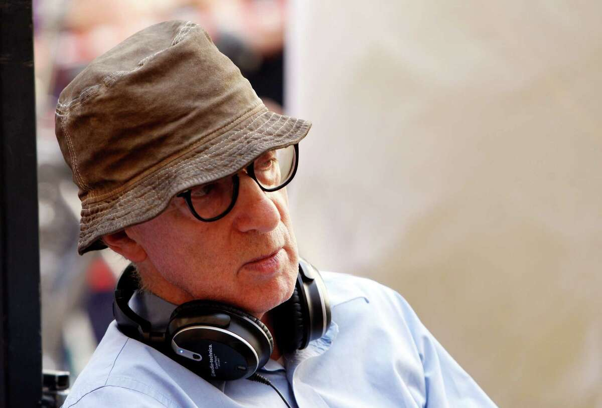 """FILE - In this July 14, 2011 file photo, filmmaker Woody Allen is shown on the set of his movie """"The Bop Decameron"""" in Rome. Dylan Farrow, the adopted daughter of Allen and Mia Farrow, penned an emotional open letter, accusing Hollywood of callously lionizing Allen, who she claims abused her. The letter revived in stunning detail an allegation more than two decades old."""
