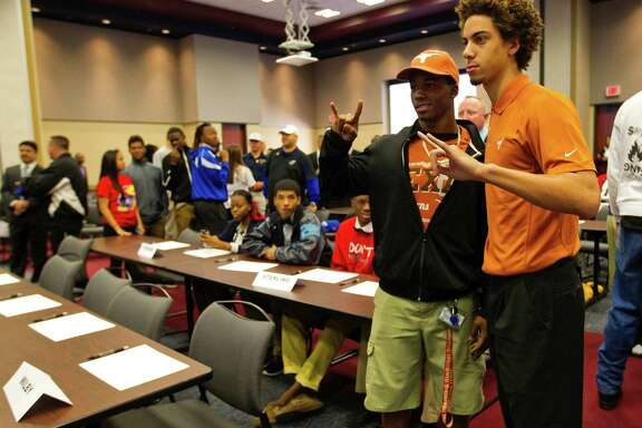 Lamar's John Bonney, right, with new UT teammate Roderick Bernard of Sharpstown, fueled a controversy last week when he revealed that Mack Brown pledged to help players find other schools if they so desired.
