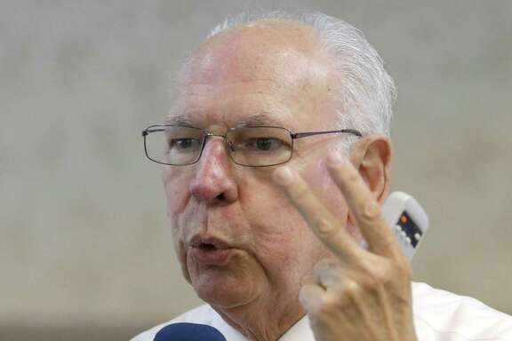 Rafael Cruz, father of U.S. Sen. Ted Cruz and a key factor in his politics, delights a Madisonville tea party crowd with attacks on President BarackObama.