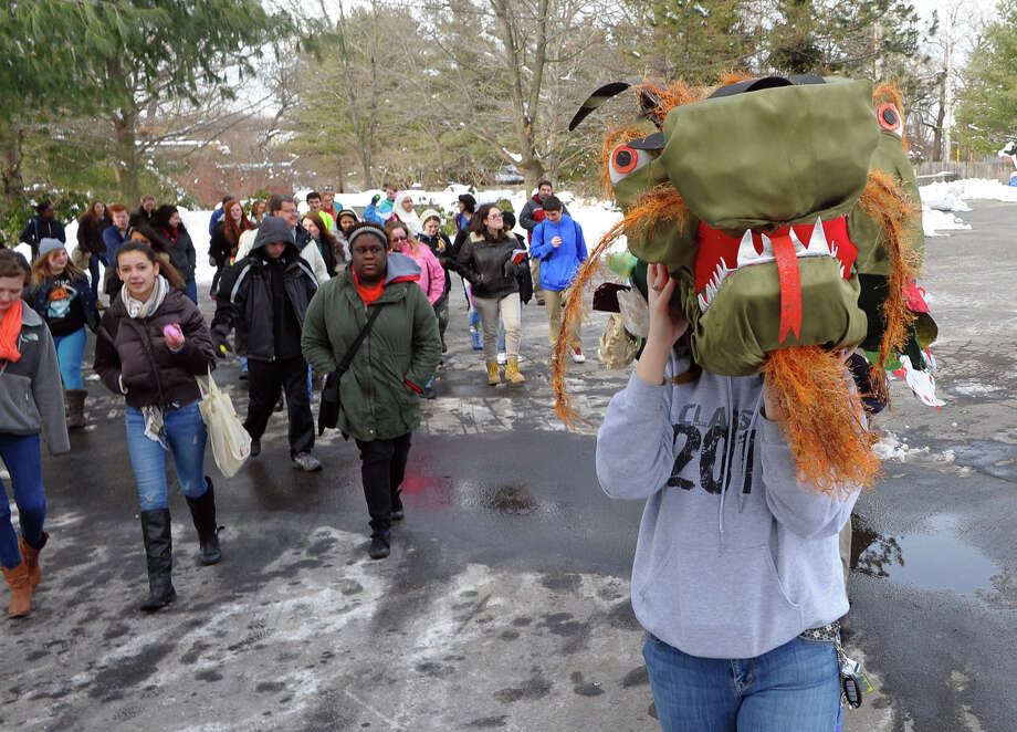 The Asian New Year Celebration was held at Beardsley Zoo in Bridgeport, Conn. on Saturday February 8, 2014. 2014 marks the Year of the Horse. For the dragon parade, teen volunteers from the zoo's Conservation Discovery Corp lead the parade with the dragon. Photo: Christian Abraham / Connecticut Post