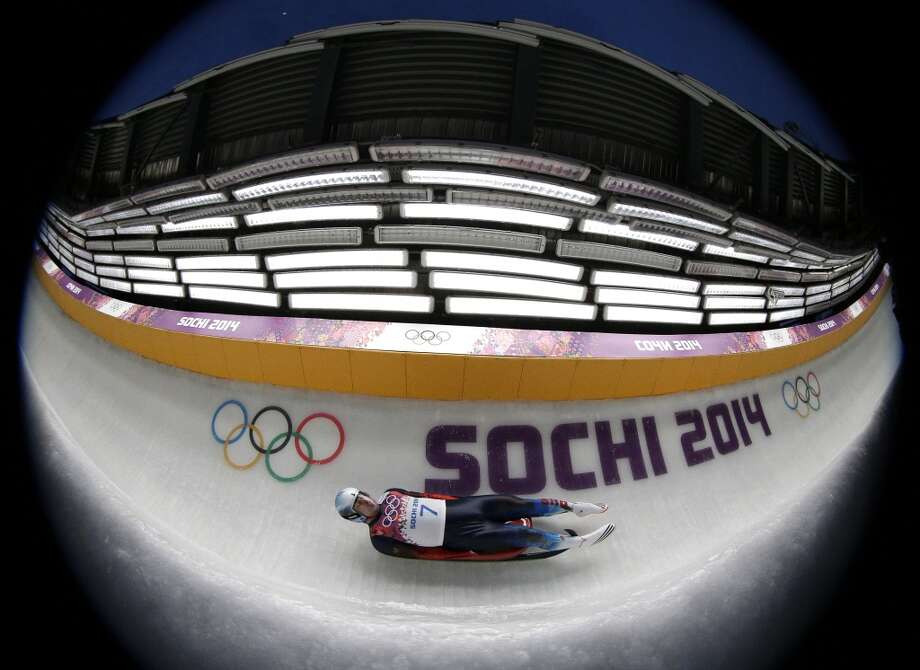 Albert Demchenko from Russia takes a turn during the first heat of the men's singles luge competition at the 2014 Winter Olympics, Saturday, Feb. 8, 2014, in Krasnaya Polyana, Russia. (AP Photo/Michael Sohn) Photo: Michael Sohn, Associated Press