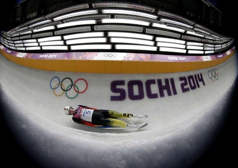 David Moeller from Germany takes a turn during the first heat of the men's singles luge competition at the 2014 Winter Olympics, Saturday, Feb. 8, 2014, in Krasnaya Polyana, Russia. (AP Photo/Michael Sohn) Photo: Michael Sohn, Associated Press