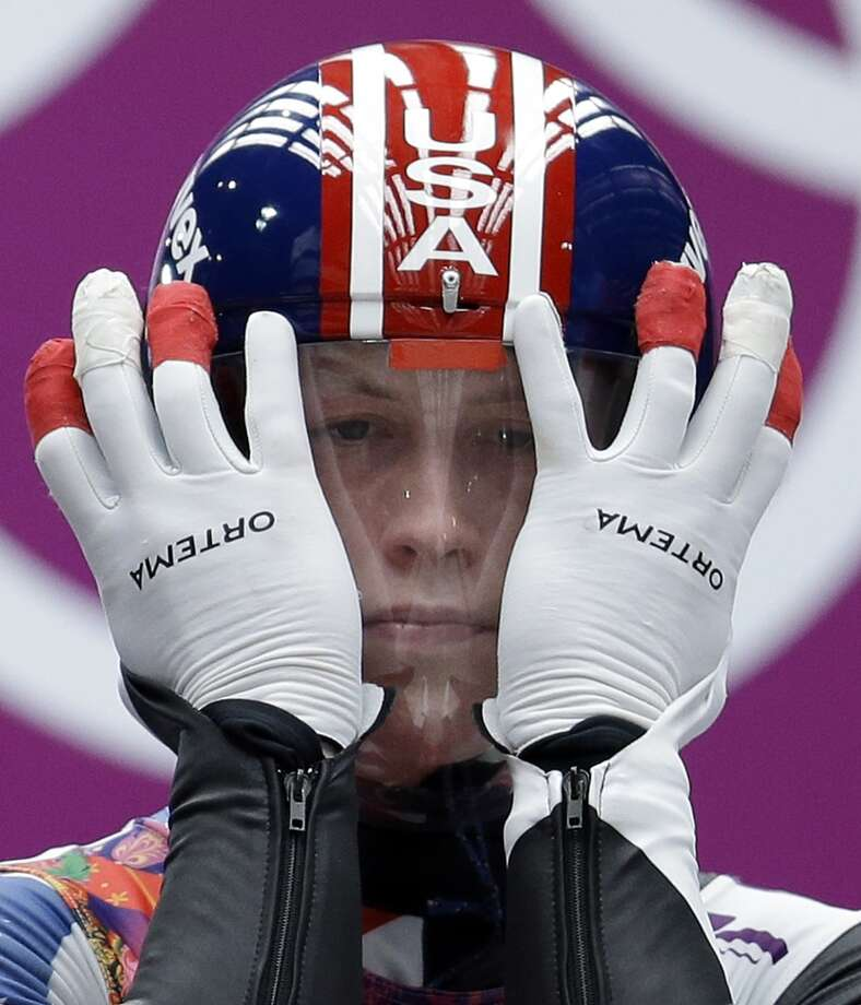 Aidan Kelly of the United States prepares for his first run during the men's singles luge competition at the 2014 Winter Olympics, Saturday, Feb. 8, 2014, in Krasnaya Polyana, Russia. (AP Photo/Natacha Pisarenko) Photo: Natacha Pisarenko, Associated Press