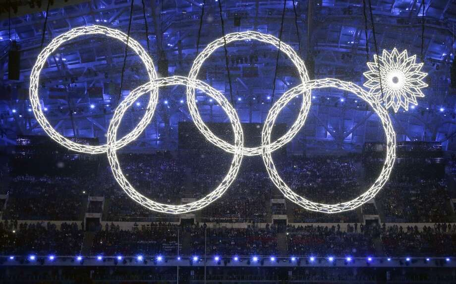One of the rings forming the Olympic Rings fails to open during the opening ceremony of the 2014 Winter Olympics in Sochi, Russia, Friday, Feb. 7, 2014. (AP Photo/Mark Humphrey) Photo: Mark Humphrey, Associated Press