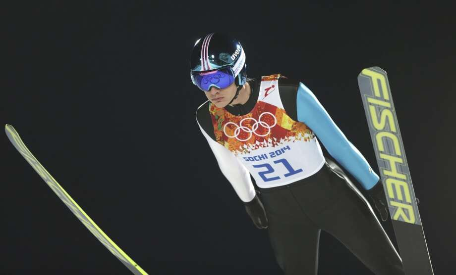 The Olympic rings are reflected in the goggles of Estonia's Kaarel Nurmsalu during the men's normal hill ski jumping qualification at the 2014 Winter Olympics, Saturday, Feb. 8, 2014, in Krasnaya Polyana, Russia. (AP Photo/Matthias Schrader) Photo: Matthias Schrader, Associated Press