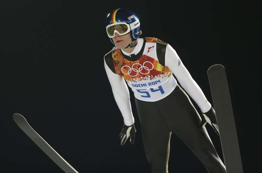 Germany's Andreas Wellinger makes an attempt during the men's normal hill ski jumping qualification at the 2014 Winter Olympics, Saturday, Feb. 8, 2014, in Krasnaya Polyana, Russia. (AP Photo/Matthias Schrader) Photo: Matthias Schrader, Associated Press