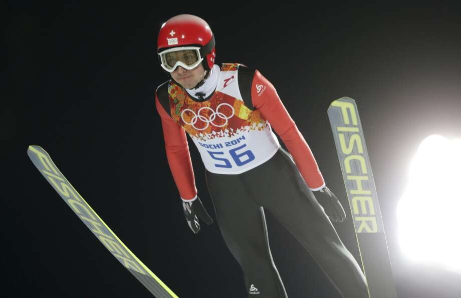Switzerland's Simon Ammann makes an attempt during the men's normal hill ski jumping qualification at the 2014 Winter Olympics, Saturday, Feb. 8, 2014, in Krasnaya Polyana, Russia. (AP Photo/Matthias Schrader) Photo: Matthias Schrader, Associated Press
