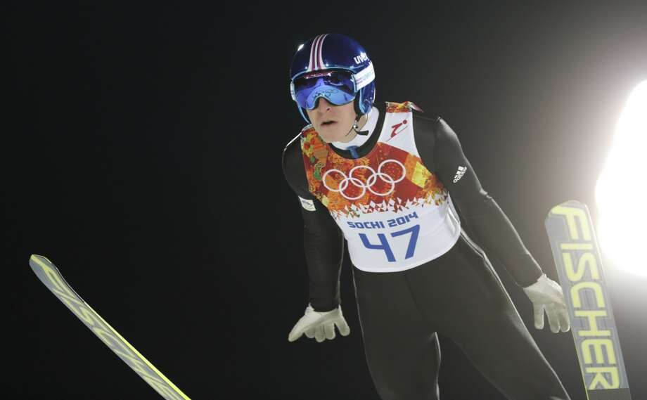 Slovenia's Jurij Tepes makes an attempt during the men's normal hill ski jumping qualification at the 2014 Winter Olympics, Saturday, Feb. 8, 2014, in Krasnaya Polyana, Russia. (AP Photo/Matthias Schrader) Photo: Matthias Schrader, Associated Press