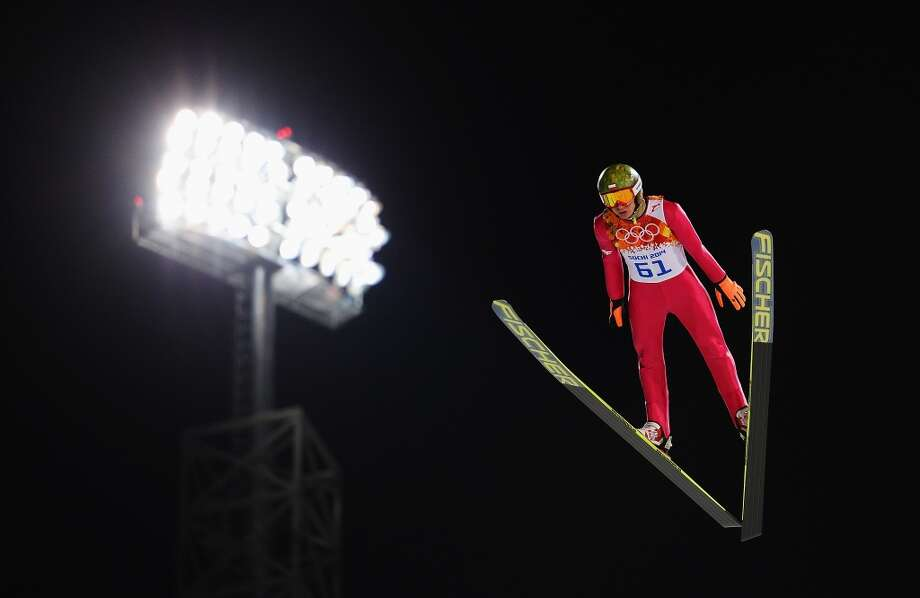 SOCHI, RUSSIA - FEBRUARY 08: Kamil Stoch of Poland jumps during the Men's Normal Hill Individual Qualification on day 1 of the Sochi 2014 Winter Olympics at the RusSki Gorki Ski Jumping Center on February 8, 2014 in Sochi, Russia.  (Photo by Lars Baron/Getty Images) Photo: Lars Baron, Getty Images