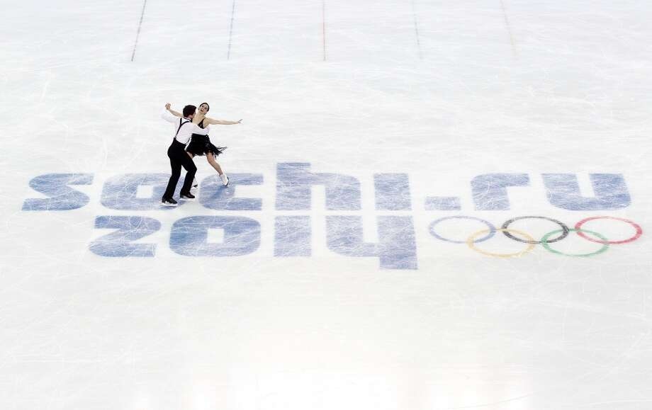 SOCHI, RUSSIA - FEBRUARY 08:  Tessa Virtue and Scott Moir of Canada compete in the Figure Skating Team Ice Dance - Short Dance during day one of the Sochi 2014 Winter Olympics at Iceberg Skating Palace on February 8, 2014 in Sochi, Russia.  (Photo by Matthew Stockman/Getty Images) Photo: Getty Images