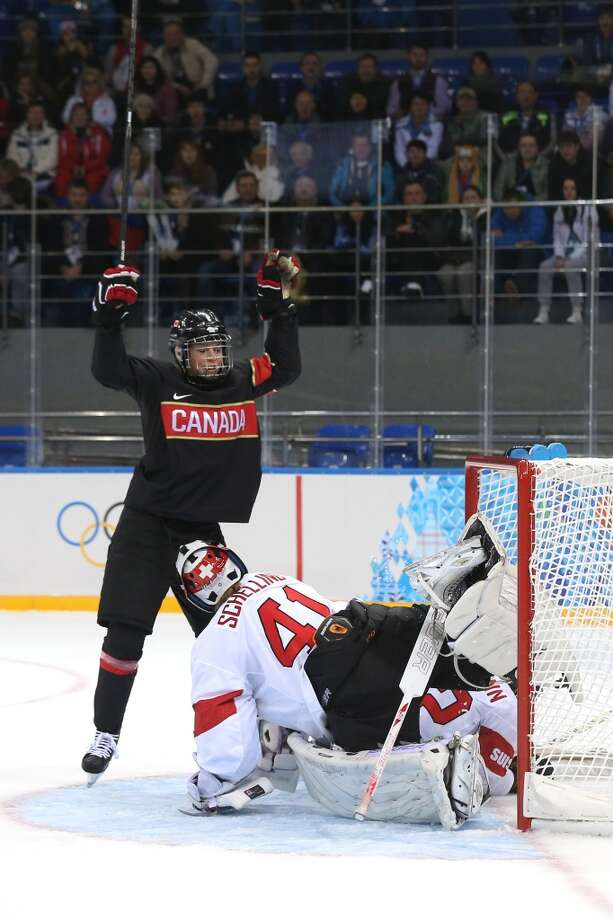 SOCHI, RUSSIA - FEBRUARY 08:  Rebecca Johnston #6 of Canada celebrates after scoring a goal against Florence Schelling #41 and Sandra Thalmann #92 of Switzerland in the second period during the Women's Ice Hockey Preliminary Round Group A Game on day 1 of the Sochi 2014 Winter Olympics at Shayba Arena on February 8, 2014 in Sochi, Russia.  (Photo by Bruce Bennett/Getty Images) Photo: Getty Images