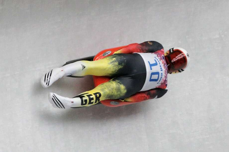 SOCHI, RUSSIA - FEBRUARY 08:  Felix Loch of Germany makes a run during the Luge Men's Singles on Day 1 of the Sochi 2014 Winter Olympics at the Sliding Center Sanki on February 8, 2014 in Sochi, Russia.  (Photo by Adam Pretty/Getty Images) Photo: Getty Images