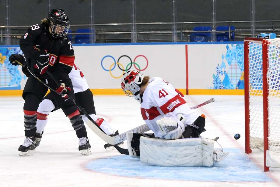 SOCHI, RUSSIA - FEBRUARY 08:  Florence Schelling #41 of Switzerland tends goal against Marie-Philip Poulin #29 of Canada during the Women's Ice Hockey Preliminary Round Group A Game on day 1 of the Sochi 2014 Winter Olympics at Shayba Arena on February 8, 2014 in Sochi, Russia.  (Photo by Bruce Bennett/Getty Images) Photo: Getty Images