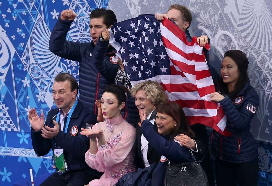 SOCHI, RUSSIA - FEBRUARY 08:  Meryl Davis and Charlie White of the United States wait for their score with teammates and coaches during the Figure Skating Team Ice Dance - Short Dance during day one of the Sochi 2014 Winter Olympics at Iceberg Skating Palace on February 8, 2014 in Sochi, Russia.  (Photo by Matthew Stockman/Getty Images) Photo: Getty Images
