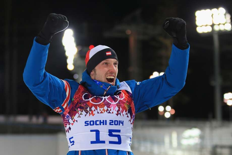 SOCHI, RUSSIA - FEBRUARY 08:  Silver medallist Dominik Landertinger of Austria celebrates during the flower ceremony forthe Men's Sprint 10 km during day one of the Sochi 2014 Winter Olympics at Laura Cross-country Ski & Biathlon Center on February 8, 2014 in Sochi, Russia.  (Photo by Richard Heathcote/Getty Images) Photo: Getty Images