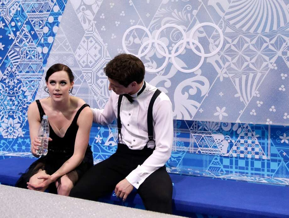 SOCHI, RUSSIA - FEBRUARY 08:  Anna Cappellini and Luca Lanotte of Italy look on after competing in the Figure Skating Team Ice Dance - Short Dance during day one of the Sochi 2014 Winter Olympics at Iceberg Skating Palace on February 8, 2014 in Sochi, Russia.  (Photo by Darren Cummings/Pool/Getty Images) Photo: Getty Images