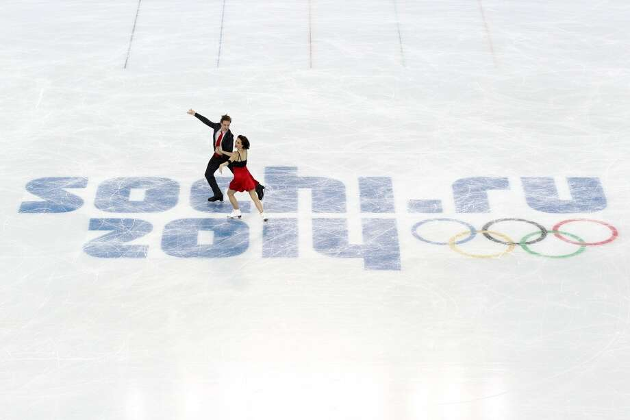 SOCHI, RUSSIA - FEBRUARY 08:  Nathalie Pechalat and Fabian Bourzat of France compete in the Figure Skating Team Ice Dance - Short Dance during day one of the Sochi 2014 Winter Olympics at Iceberg Skating Palace on February 8, 2014 in Sochi, Russia.  (Photo by Matthew Stockman/Getty Images) Photo: Getty Images