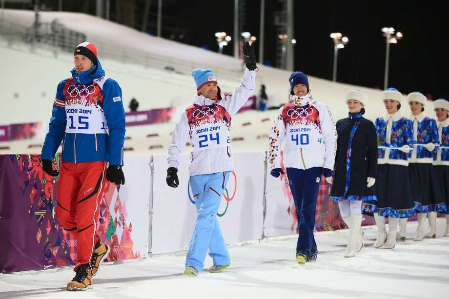 SOCHI, RUSSIA - FEBRUARY 08: Gold medalist Ole Einar Bjoerndalen (C) of Norway, silver medallist Dominik Landertinger of Austria (L) and bronze medallist Jaroslav Soukup of the Czech Republic arrive for the flower ceremony for the Men's Sprint 10 km during day one of the Sochi 2014 Winter Olympics at Laura Cross-country Ski & Biathlon Center on February 8, 2014 in Sochi, Russia.  (Photo by Richard Heathcote/Getty Images) Photo: Getty Images