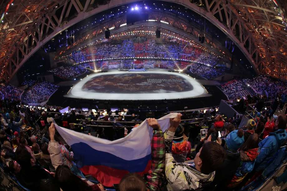 Spectators wave the Russian flag during the opening ceremony of the 2014 Winter Olympics in Sochi, Russia, Friday, Feb. 7, 2014. (AP Photo/Charlie Riedel) Photo: Associated Press