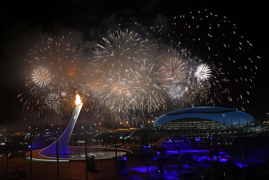 Fireworks are seen over the Olympic Park during the opening ceremony of the 2014 Winter Olympics in Sochi, Russia, Friday, Feb. 7, 2014. (AP Photo/Julio Cortez) Photo: Associated Press