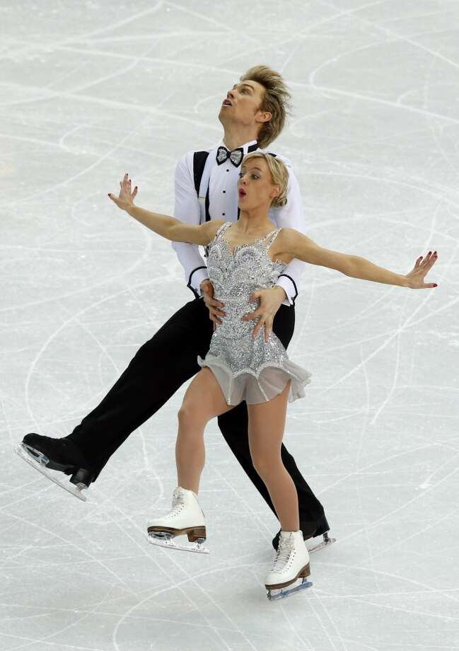 Great Britain's Nicholas Buckland and Great Britain's Penny Coomes perform in the Figure Skating Team Ice Dance Short Dance at the Iceberg Skating Palace during the Sochi Winter Olympics on February 8, 2014.  AFP PHOTO / ADRIAN DENNISADRIAN DENNIS/AFP/Getty Images Photo: AFP/Getty Images