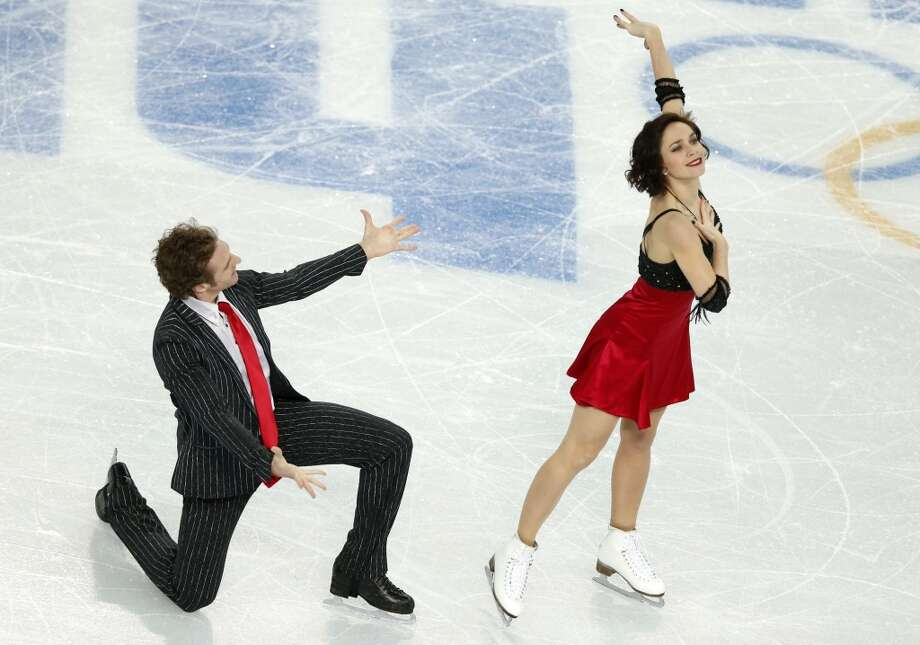 France's Fabian Bourzat and France's Nathalie Pechalat perform in the Figure Skating Team Ice Dance Short Dance at the Iceberg Skating Palace during the Sochi Winter Olympics on February 8, 2014. AFP PHOTO / ADRIAN DENNISADRIAN DENNIS/AFP/Getty Images Photo: AFP/Getty Images