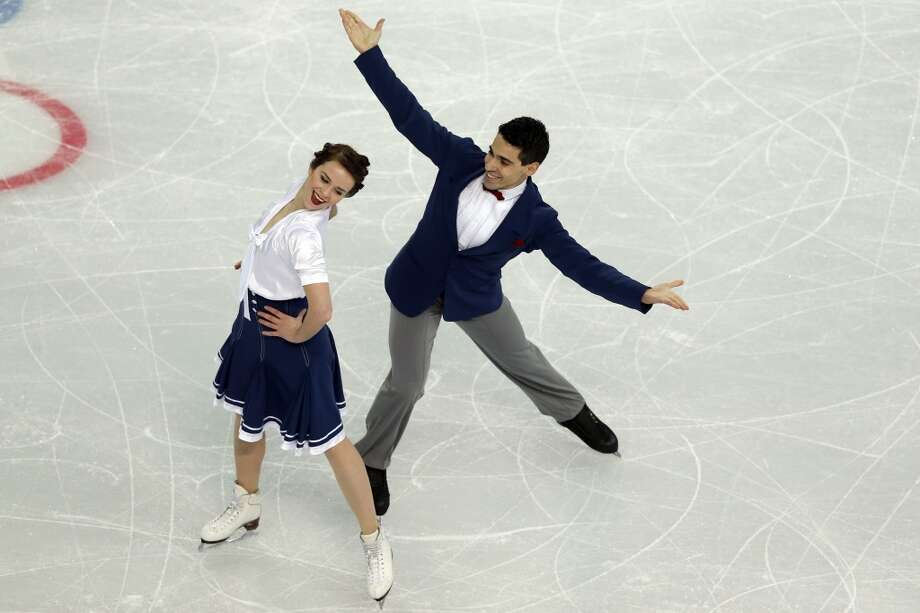 Italy's Anna Cappellini and Italy's Marco Fabbri perform in the Figure Skating Team Ice Dance Short Dance at the Iceberg Skating Palace during the Sochi Winter Olympics on February 8, 2014.  AFP PHOTO / ADRIAN DENNISADRIAN DENNIS/AFP/Getty Images Photo: AFP/Getty Images