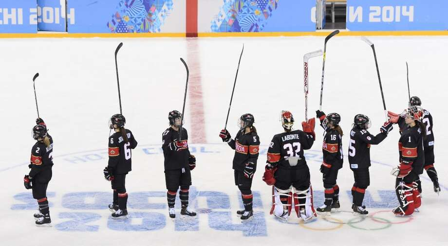 Canada's players celebrate after winning the Women's Ice Hockey Group A match between Canada and Switzerland at the Shayba Arena during the Sochi Winter Olympics on February 8, 2014. Canada won 5-0.    AFP PHOTO / JONATHAN NACKSTRANDJONATHAN NACKSTRAND/AFP/Getty Images Photo: AFP/Getty Images
