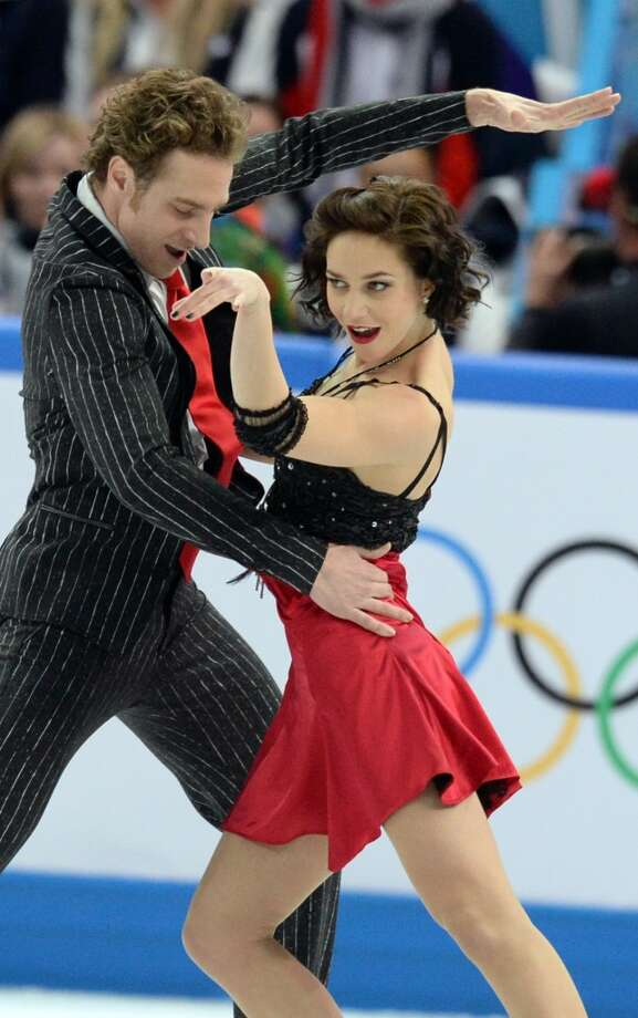France's Fabian Bourzat and France's Nathalie Pechalat perform in the Figure Skating Team Ice Dance Short Dance at the Iceberg Skating Palace during the Sochi Winter Olympics on February 8, 2014.   AFP PHOTO / YURI KADOBNOVYURI KADOBNOV/AFP/Getty Images Photo: AFP/Getty Images