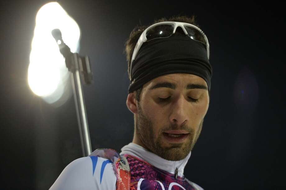 France's Martin Fourcade reacts during the Men's Biathlon 10 km Sprint at the Laura Cross-Country Ski and Biathlon Center during the Sochi Winter Olympics on February 8, 2014 in Rosa Khutor. AFP PHOTO / ODD ANDERSENODD ANDERSEN/AFP/Getty Images Photo: AFP/Getty Images