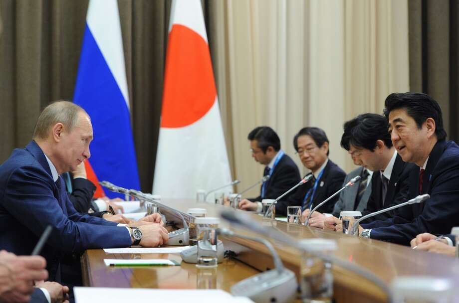 Russia's President Vladimir Putin (L) meets with Japanese Prime Minister Shinzo Abe (R) at the Bocharov Ruchei residence in Sochi on February 8, 2014. AFP PHOTO / RIA-NOVOSTI / POOL / Mikhail KlimentievMIKHAIL KLIMENTIEV/AFP/Getty Images Photo: AFP/Getty Images