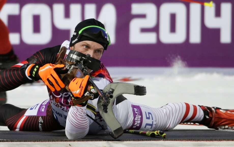 Austria's Dominik Landertinger prepares to shoot during the men's biathlon 10k sprint, at the 2014 Winter Olympics, Saturday, Feb. 8, 2014, in Krasnaya Polyana, Russia. Austria's Dominik Landertinger won the silver medal. (AP Photo/Gero Breloer) Photo: Associated Press