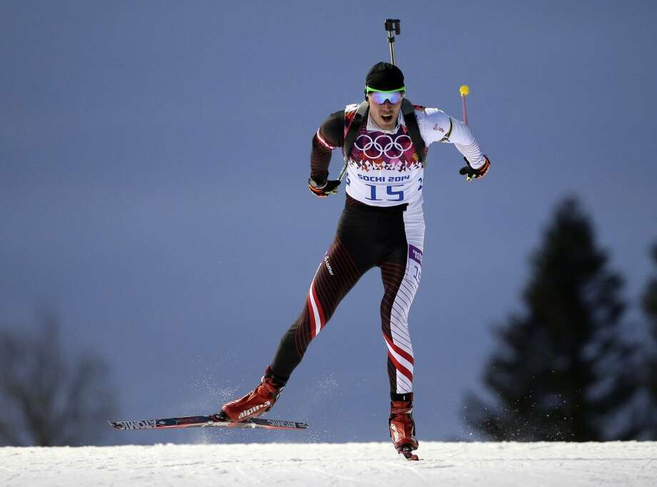 Austria's Dominik Landertinger competes on his way to win the silver medal in the men's biathlon 10k sprint, at the 2014 Winter Olympics, Saturday, Feb. 8, 2014, in Krasnaya Polyana, Russia. (AP Photo/Felipe Dana) Photo: Associated Press