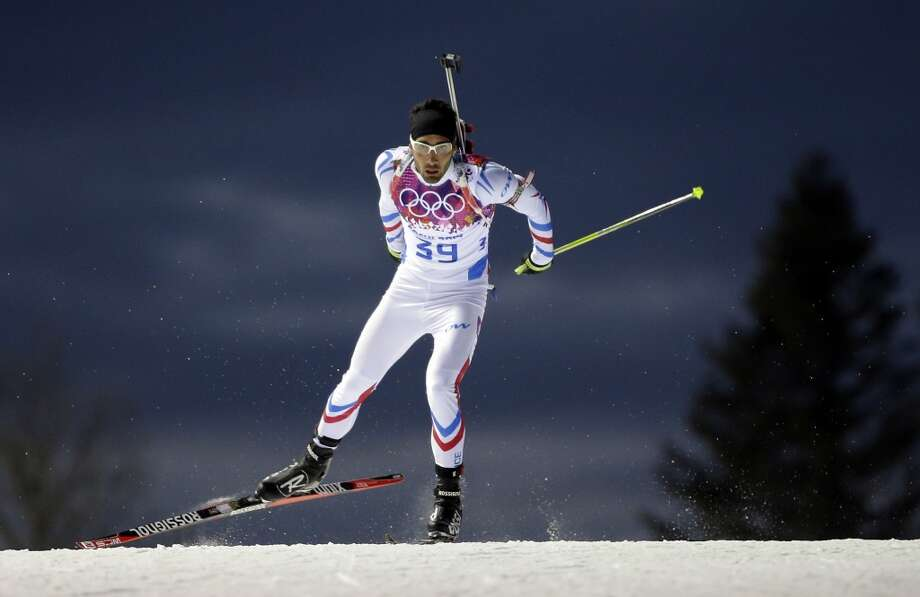 France's Martin Fourcade competes during the men's biathlon 10k sprint, at the 2014 Winter Olympics, Saturday, Feb. 8, 2014, in Krasnaya Polyana, Russia. (AP Photo/Felipe Dana) Photo: Associated Press