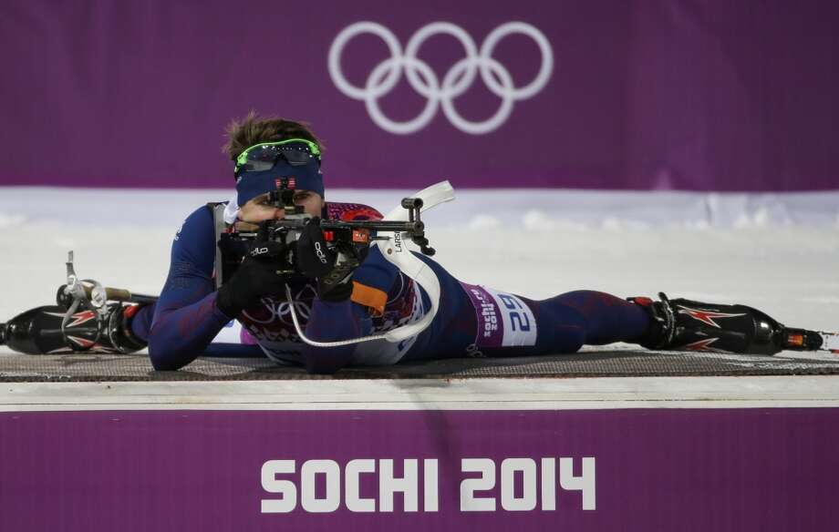 Norway's Emil Hegle Svendsen shoots during the men's biathlon 10k sprint, at the 2014 Winter Olympics, Saturday, Feb. 8, 2014, in Krasnaya Polyana, Russia. (AP Photo/Gero Breloer) Photo: Associated Press