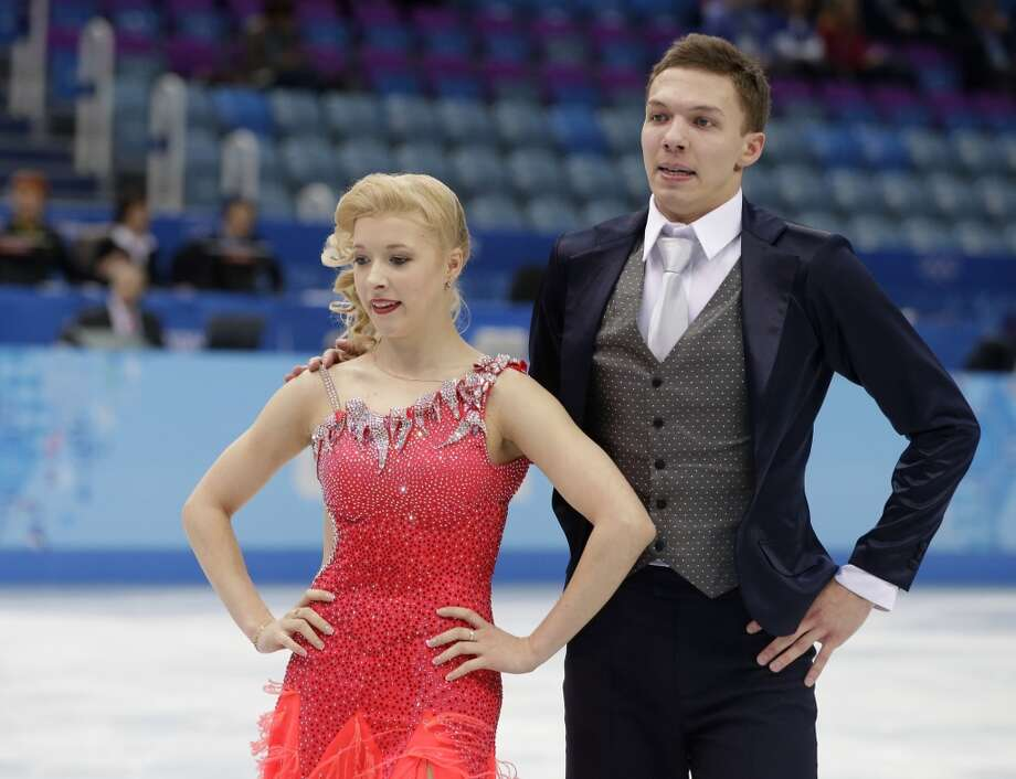 Ekaterina Bobrova and Dmitri Soloviev of Russia leave the ice after competing in the team ice dance short dance figure skating competition at the Iceberg Skating Palace during the 2014 Winter Olympics, Saturday, Feb. 8, 2014, in Sochi, Russia. (AP Photo/Darron Cummings, Pool) Photo: Associated Press
