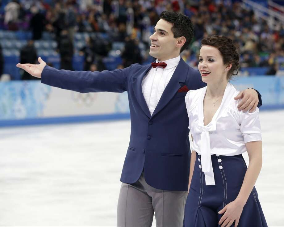 Tessa Virtue and Scott Moir of Canada leave the ice after competing in the team ice dance short dance figure skating competition at the Iceberg Skating Palace during the 2014 Winter Olympics, Saturday, Feb. 8, 2014, in Sochi, Russia. (AP Photo/Darron Cummings, Pool) Photo: Associated Press
