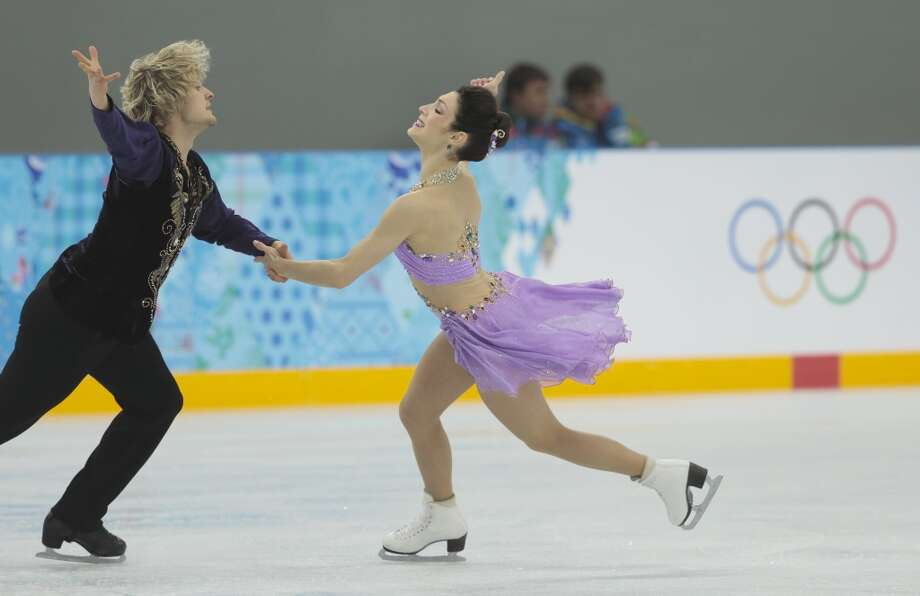 Meryl Davis and Charlie White of the United States skate at the figure skating practice rink ahead of the 2014 Winter Olympics, Wednesday, Feb. 5, 2014, in Sochi, Russia. (AP Photo/Ivan Sekretarev) Photo: Associated Press