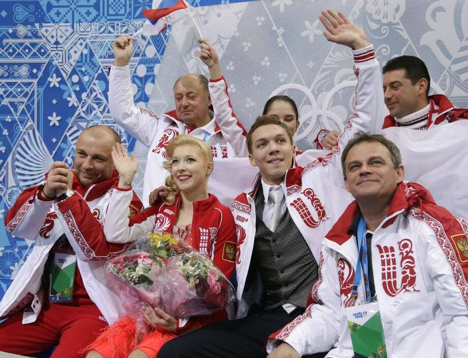 Ekaterina Bobrova and Dmitri Soloviev of Russia wave to spectators after competing in the team ice dance short dance figure skating competition at the Iceberg Skating Palace during the 2014 Winter Olympics, Saturday, Feb. 8, 2014, in Sochi, Russia. (AP Photo/Darron Cummings, Pool) Photo: Associated Press