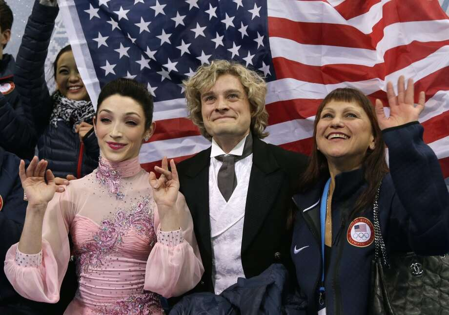 Meryl Davis and Charlie White of the United States wait for their results after competing in the team ice dance short dance figure skating competition at the Iceberg Skating Palace during the 2014 Winter Olympics, Saturday, Feb. 8, 2014, in Sochi, Russia. (AP Photo/Darron Cummings, Pool) Photo: Associated Press