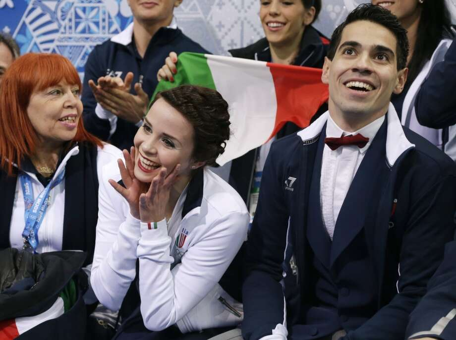 Anna Cappellini and Luca Lanotte of Italy wait for their results after competing in the team ice dance short dance figure skating competition at the Iceberg Skating Palace during the 2014 Winter Olympics, Saturday, Feb. 8, 2014, in Sochi, Russia. (AP Photo/Darron Cummings, Pool) Photo: Associated Press