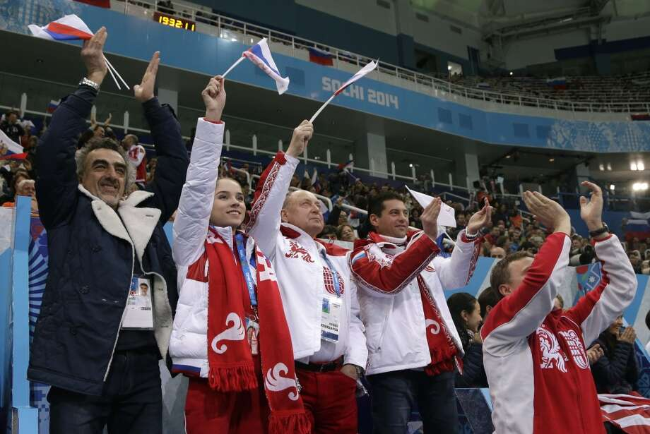 Russian team members cheer during the team ice dance short dance figure skating competition at the Iceberg Skating Palace during the 2014 Winter Olympics, Saturday, Feb. 8, 2014, in Sochi, Russia. (AP Photo/Darron Cummings, Pool) Photo: Associated Press