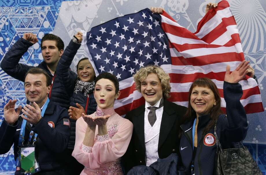 Meryl Davis and Charlie White of the United States, centre, wait for their results after competing in the team ice dance short dance figure skating competition at the Iceberg Skating Palace during the 2014 Winter Olympics, Saturday, Feb. 8, 2014, in Sochi, Russia. (AP Photo/Darron Cummings, Pool) Photo: Associated Press