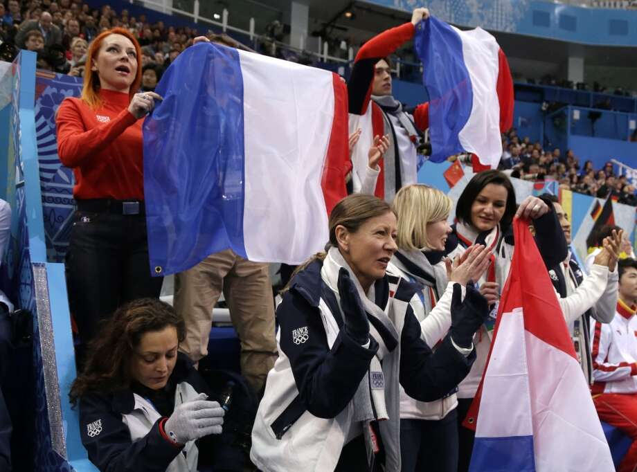 The French team cheer during the team ice dance short dance figure skating competition at the Iceberg Skating Palace during the 2014 Winter Olympics, Saturday, Feb. 8, 2014, in Sochi, Russia. (AP Photo/Darron Cummings, Pool) Photo: Associated Press