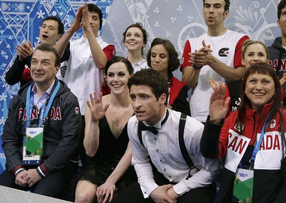 Tessa Virtue and Scott Moir of Canada wait for their results after competing in the team ice dance short dance figure skating competition at the Iceberg Skating Palace during the 2014 Winter Olympics, Saturday, Feb. 8, 2014, in Sochi, Russia. (AP Photo/Darron Cummings, Pool) Photo: Associated Press